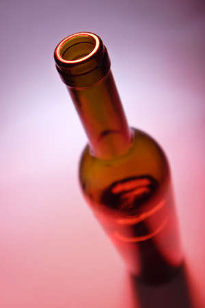 ambient: opened bottle of red wine on red ambient background