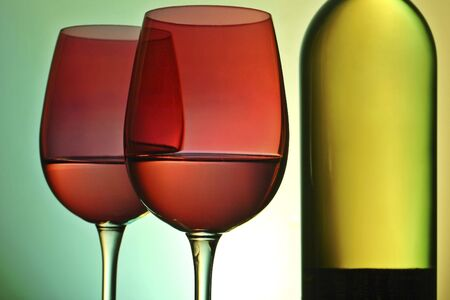 ambient: wine bottle and glasses with ambient lighting