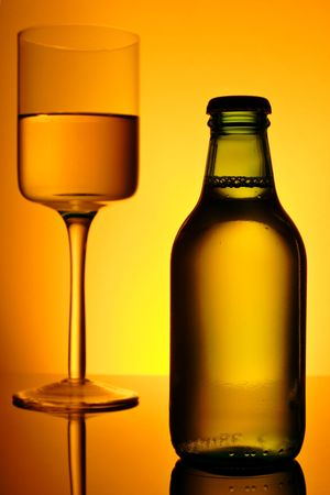 ambient light: bottle  and glass of alcohol with golden ambient light