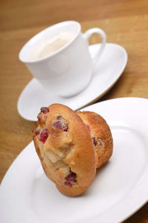 indulgent: cherry  muffin and cup of coffee
