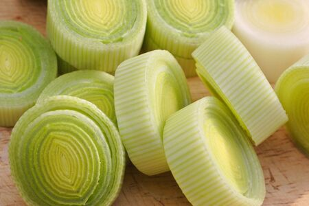 freshly prepared: freshly prepared sliced leeks on wooden chopping board Stock Photo