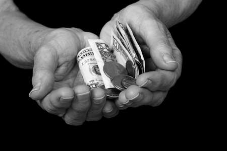 nana: elderly ladies hands outstretched with money.