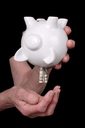 pillage: old lady plundering savings Stock Photo