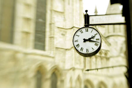 place of interest: Victorian clock in York, England ,with york minster in the background. Stock Photo