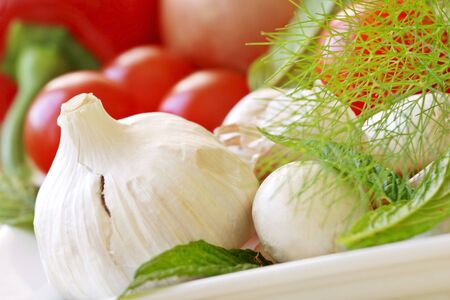 mouth watering: an assortment of mouth watering vegetables  suitable for any table. Focus on garlic bulb