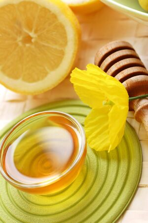 deliciously: Why not try pure clear honey, a deliciously sweet taste combined with the zestyness of a freshly sliced lemon. A natural way to start the day. Stock Photo