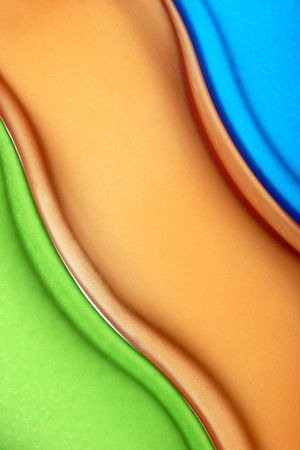 three beautiful textured glass bottles in a row showing their shapely curves. A great colorful background photo