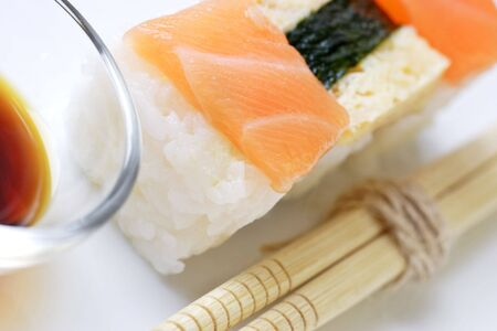 soysauce: freshly made nigirizushi with salmon topping and soysauce dip.