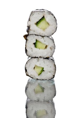 freshly prepared: freshly prepared maki rolls, a real treat for sushi lovers.Reflected onto a  glass plate