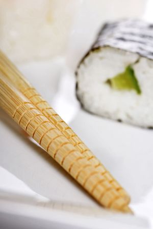 freshly prepared: freshly prepared maki rolls, a real treat for sushi lovers, focus on chopsticks.