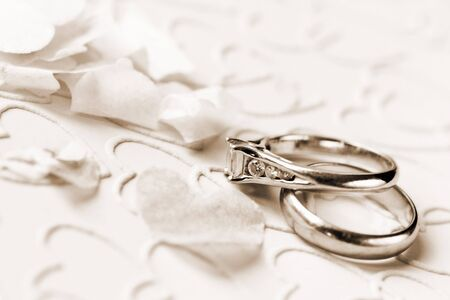 loveheart: engagement ring and wedding ring, toned sepia