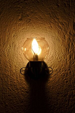 dimly: old fashioned wall light with modern energy saving bulb
