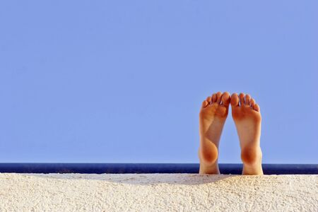 feet taking a rest in the hot summer sunshine Stock Photo