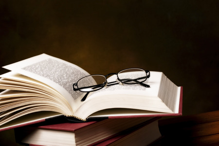 text book: pile of reading books and spectacles Stock Photo