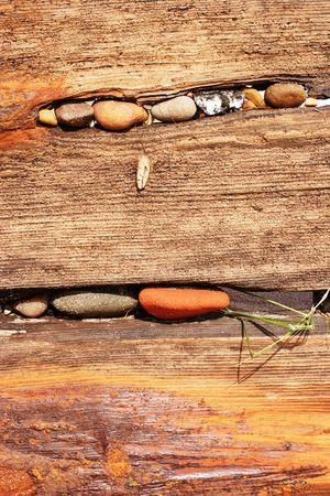 groyne: old worn beach groyne and pebbles