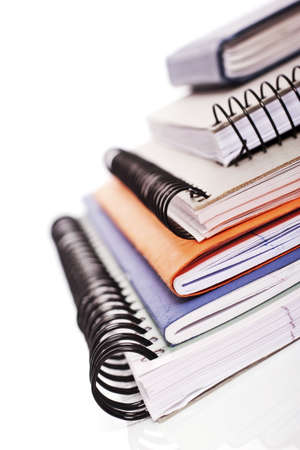 written communication: pile of school jotter books