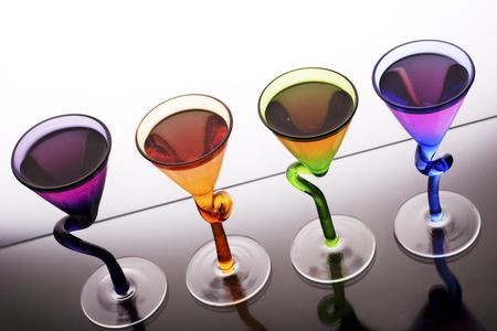 decadent: pink coloured schnapps shots in trendy glasses, ready to party.