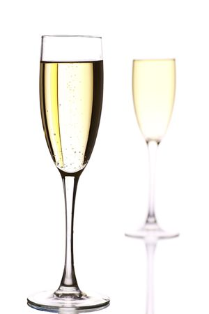 two champagne flutes, one  behind the other.