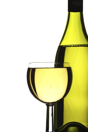 wine bottle and glass of freshly poured white wine.  Stock Photo