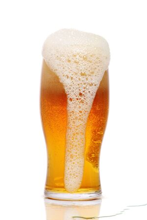 thirst quenching: Pint of freshly poured beer
