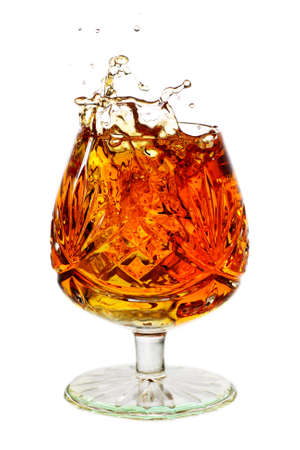 brim: snifter glass full to the brim with brandy and splash