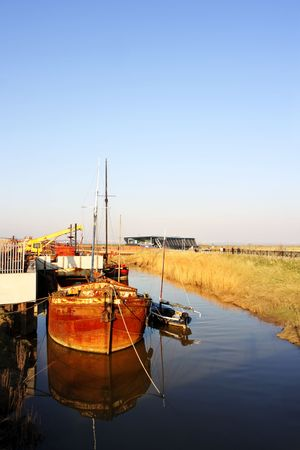 yorkshire and humber: old rusty boat moored in the  river Hull, Humberside;England