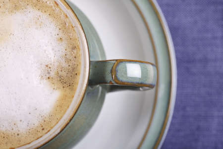 frothy: freshly poured coffee with frothy milk, focus on bubbles Stock Photo