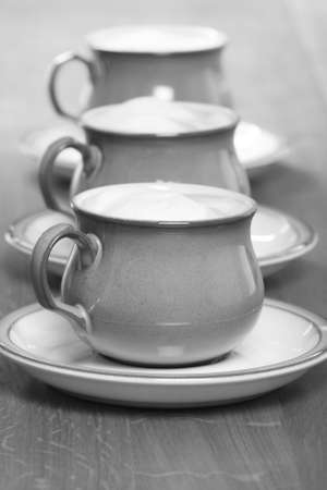 black and white coffee cups in a row. Stock Photo - 2576034