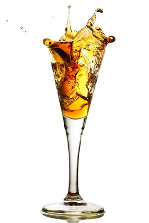 elegant cocktail glass with splash of drink, port, sherry any amber colored liquid Stock Photo