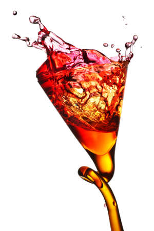 cordial: elegant drinking glass with pink colored beverage Stock Photo