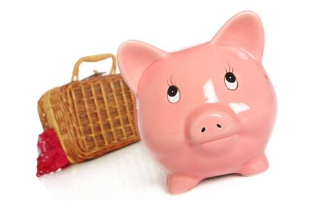 pink piggybank with suitcase packed for vacation  moving house  leaving photo
