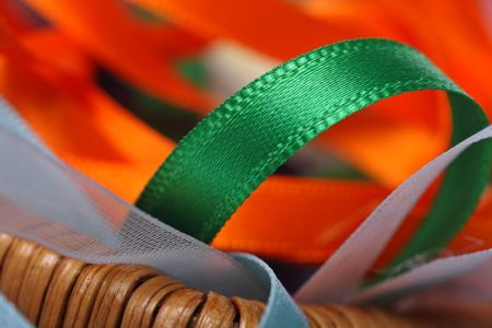 sewing box: Assorted colorful ribbons found in a sewing box