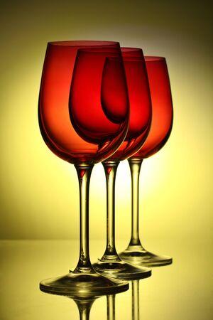 three beautiful wine glasses, backlit photo