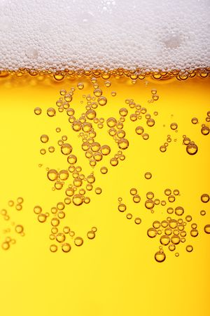 buoyant: lots of bubbles floating in a drink with froth on top