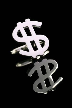 cufflink: silver dollar cufflink on a reflective surface Stock Photo