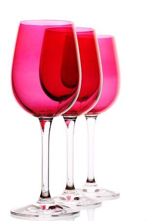 three elegant wine glasses all in a row photo