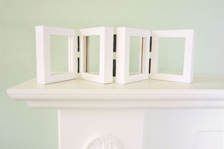 mantelpiece: mantel with empty picture frame for your pictures