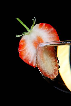sliced strawberry on a champagne coupe glass photo