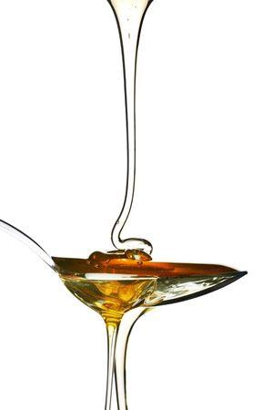 cuiller�e: cuill�re � soupe de miel d�licieusement sucr�