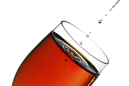 glass of sherry with a splash and drips