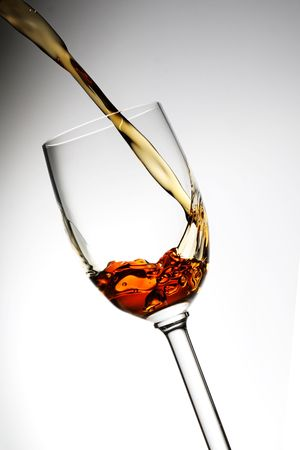 sherry being poured into a grappa glass photo