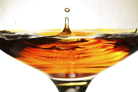 brandy splash in a snifter glass Stock Photo