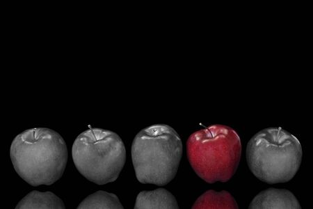 five apples in a row with selective colour applied photo
