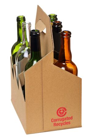 corrugated cardboard bottle carrier with empty glass bottles photo