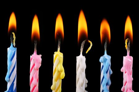 striped birthday candles in a row Stock Photo