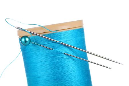 threaded: cotton reel with pin, needle and thread