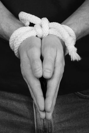 mans hands tied together photo