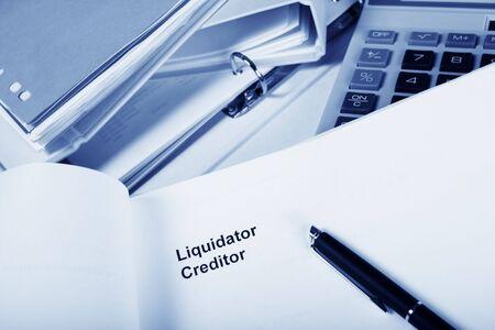 arrears: office with paper work headed liquidators, creditors. Stock Photo