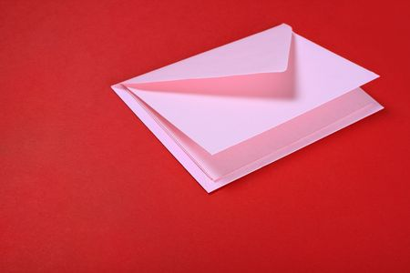 notelet: pastel pink envelope and letter on red Stock Photo