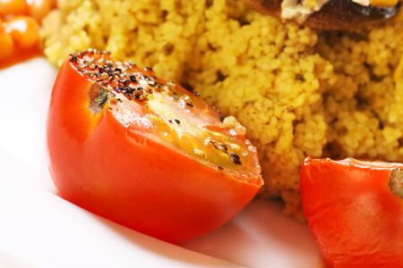 seasoned: cooked tomatoes with black pepper seasoning with couscous